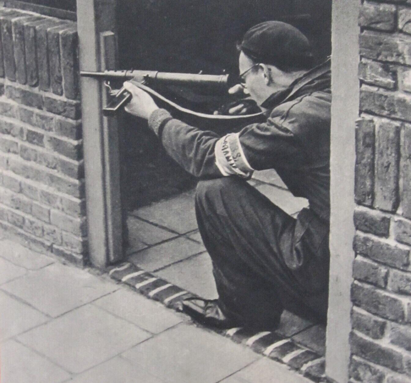 My grandfather, fighting for the Dutch resistance in Delft during WWII. He says he looks all cool but was actually shitting himself. ... and look at those shinie shoes!.jpg