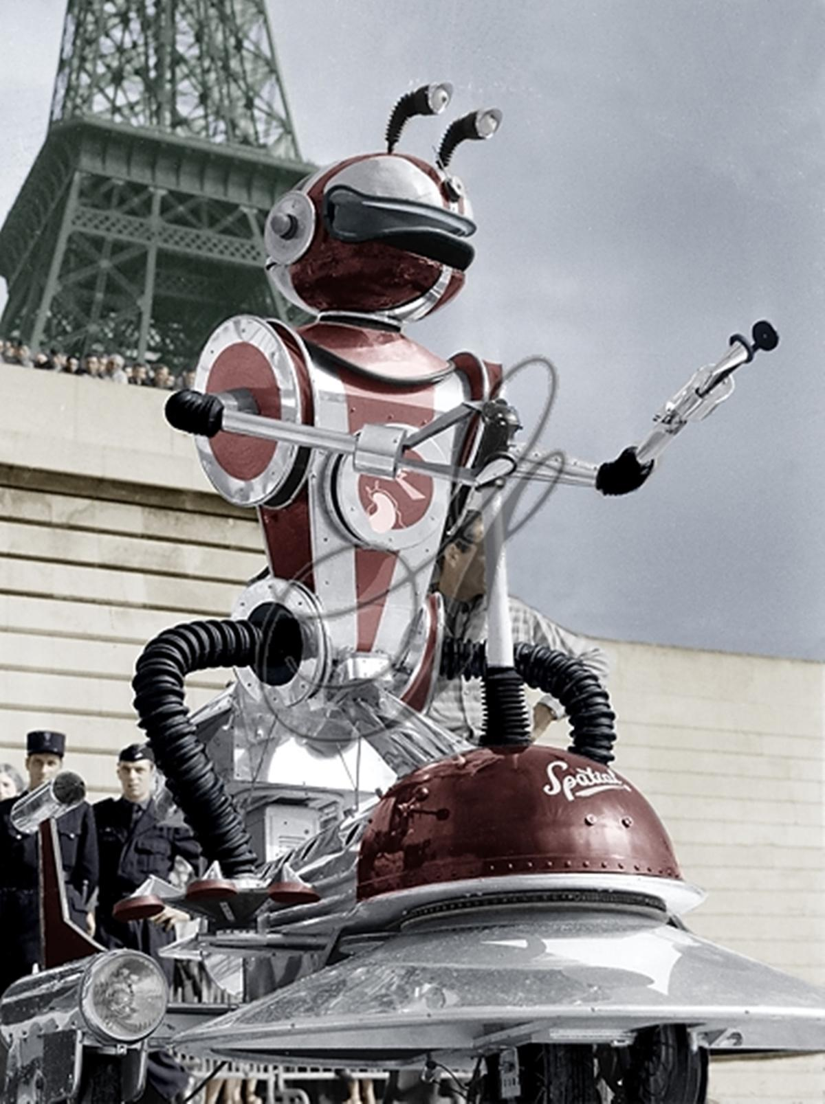 1958 Cosmo the Robot, French message-delivery robot on an electric scooter.jpg