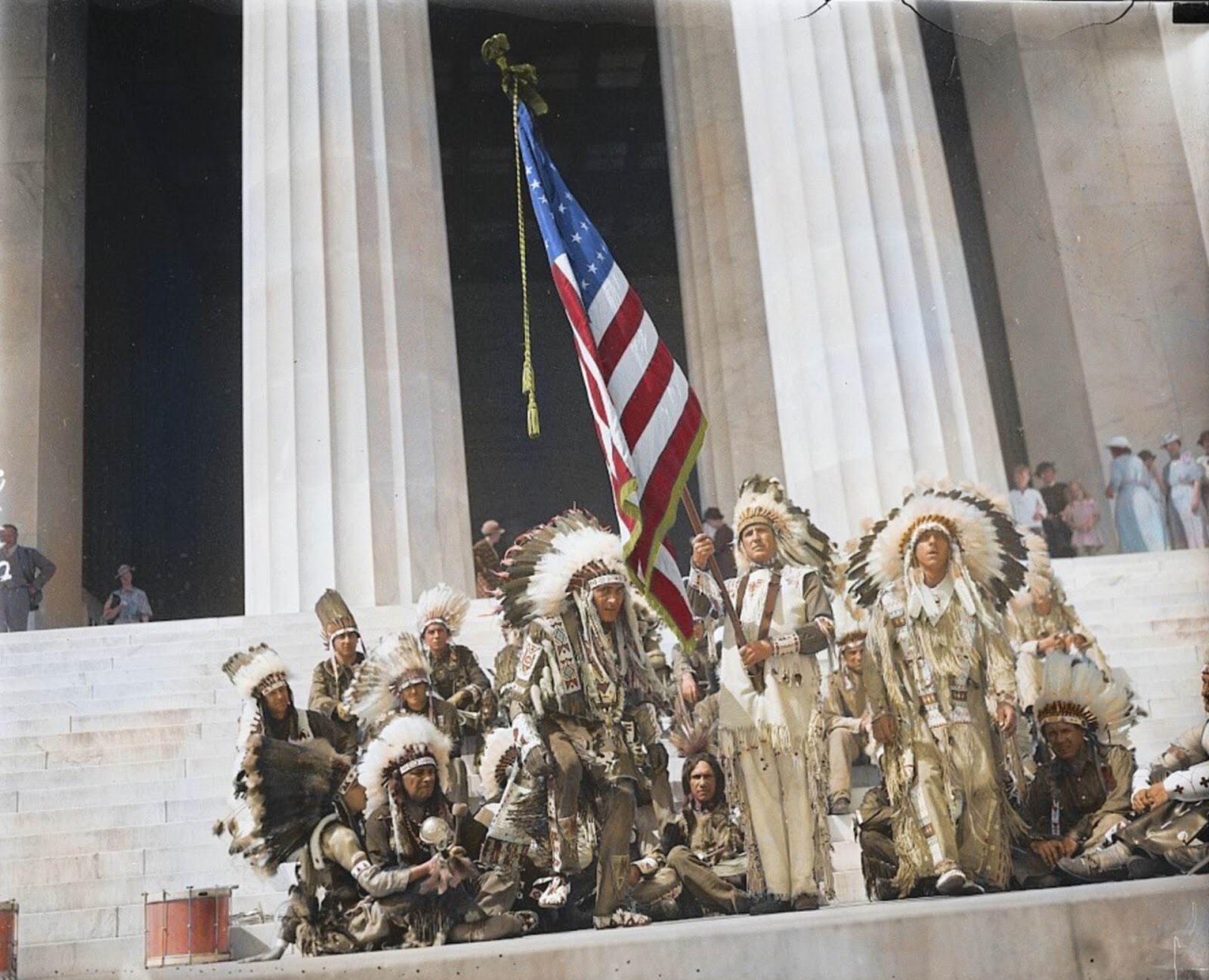 1936. Native American men wearing their traditional attire while raising the Stars and Stripes at the Lincoln Memorial. 12 years after President Calvin Coolidge granted them US citizenship.jpg