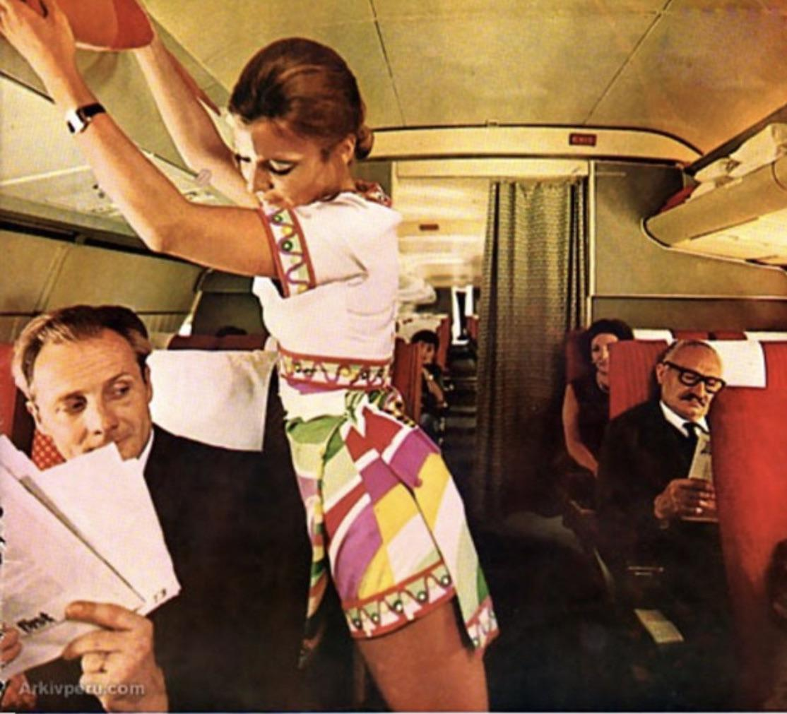 Braniff stewardess, 1970s. (When I typed Braniff, my phone tried to autocorrect to Bra off)..jpg