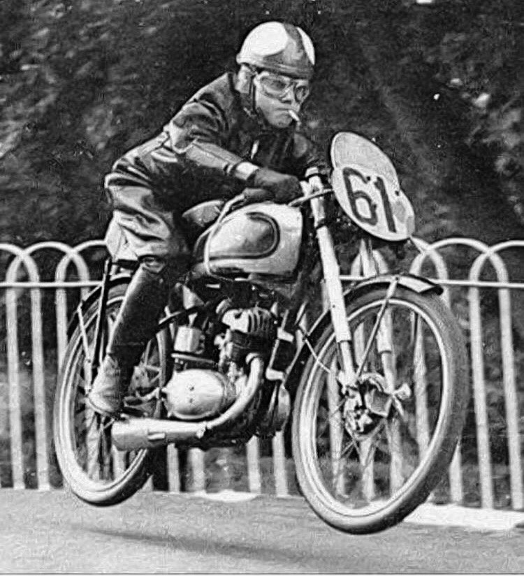 Harvey Williams smoking a cigarette while he's getting some air during the 1952 Isle of Man TT..jpg