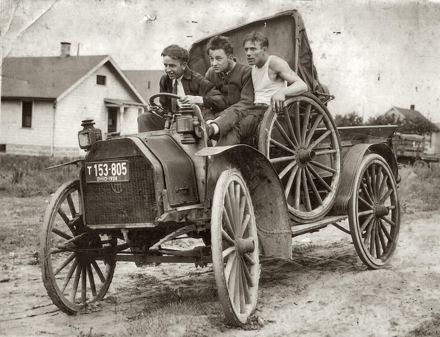 Three young men in a vehicle, circa 1924.jpg