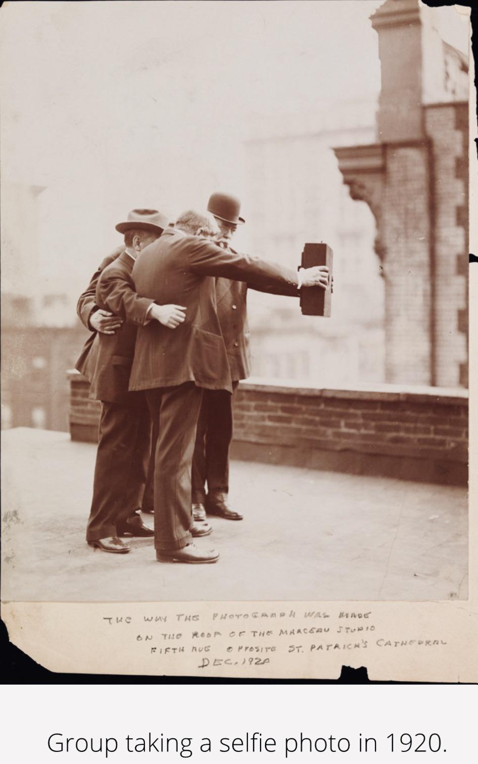Group taking a selfie photo; circa 1920.jpg