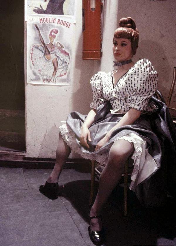 A Moulin Rouge dancer having a rest. Paris 1953.jpg