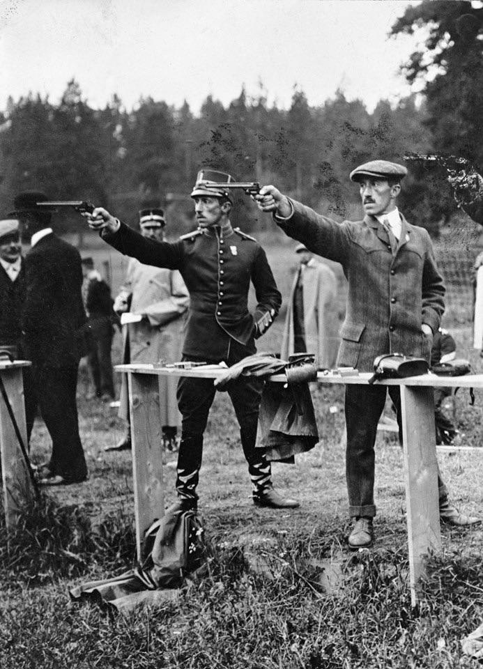 Olympics in Stockholm 1912. Lieutenants Eric and Wilhelm Carlberg (twins) shooting pistol. They won serveral gold, silver and bronze medals.jpg